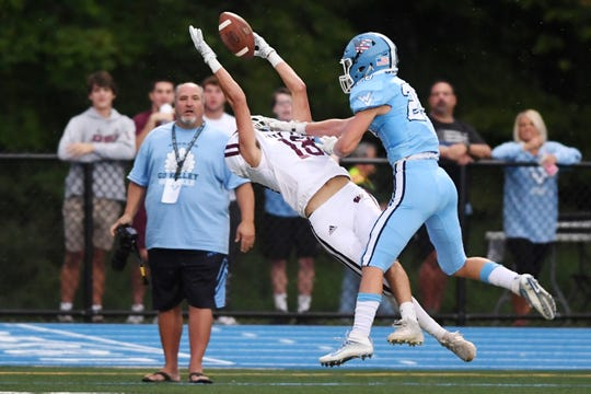 Wayne Hills football at Wayne Valley on Saturday, September 14, 2019. WH #18 Christian Puntolillo on his way to making a catch.