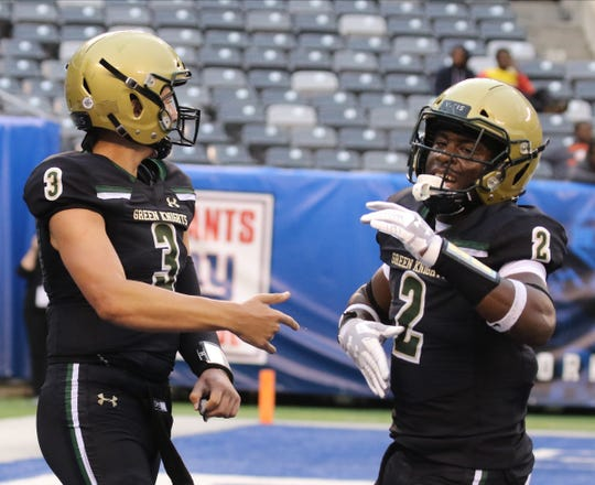 Michael Alaimo and Audric Estime of St. Joseph celebrate AlaimoÕs his first half TD during the Battle for the Bridge High School Football competition at Metlife Stadium in East Rutherford , NJ on September 14, 2019.