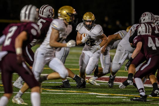 Ridgewood High School football plays Old Tappan in Ridgewood on Friday September 13, 2019. Old Tappan #22 William Rodriguez runs with the ball.