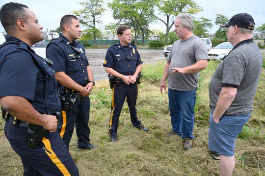 Lewis Palmer of the Louisville Navel Museum speaks with Hackensack Policemen about his groups efforts to survey the USS Ling which was vandalized in 2018.    Chris Monroe/ Special to NorthJersey.com