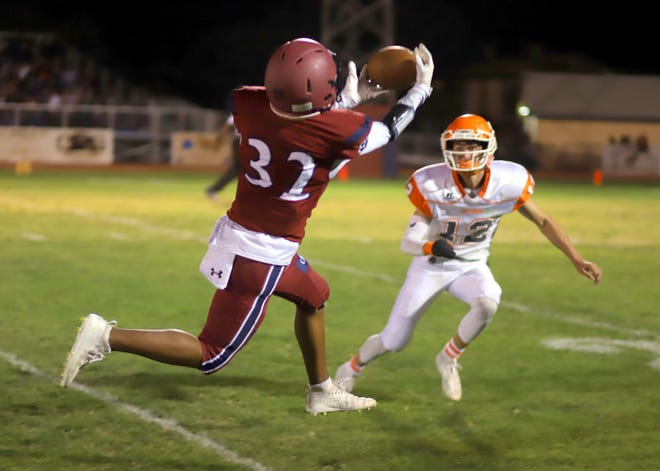 Junior wide receiver Jordan Caballero (32) pulled in this Tony Aguilar pass that covered 32 yards to the Artesia 22-yard line.