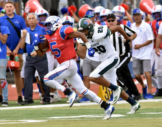 Las Cruces High's Johnny Terrazas breaks out for a long gain against the Rio Rancho Rams during the first half of Saturday's game at the Field of Dreams.