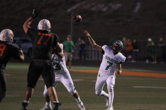 Farmington's Caleb Carrillo fires a pass deep into the right corner against Aztec during Friday's football game at Fred Cook Memorial Stadium in Aztec.