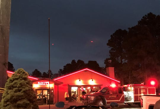 State Police investigate the scene at Farley's after a vehicle crashed through the restaurant injuring several people.