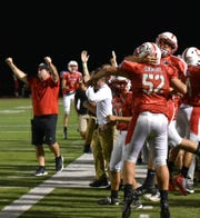 Canton Chiefs celebrate their fourth quarter touchdown that brough them within 2 points of Plymouth.