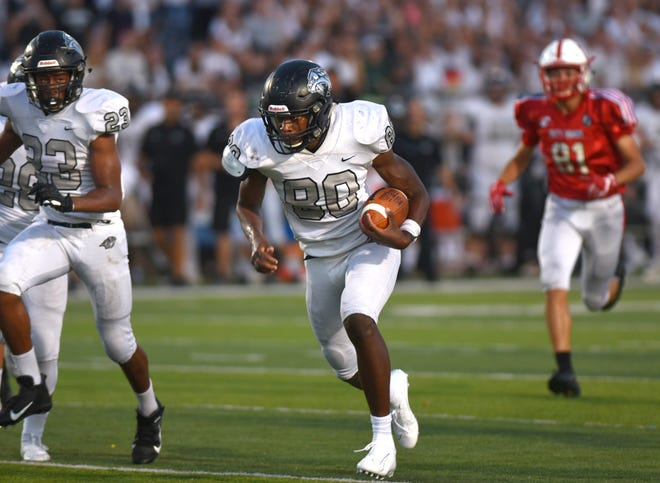 Plymouth's Ivan Davis returns a Canton blocked punt for the Wildcat's first touchdown.
