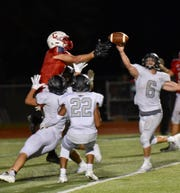 Canton's Caden Domzalski makes a miracle touchdown catch in triple coverage on 4th and 20 in the fourth quarter against Plymouth.