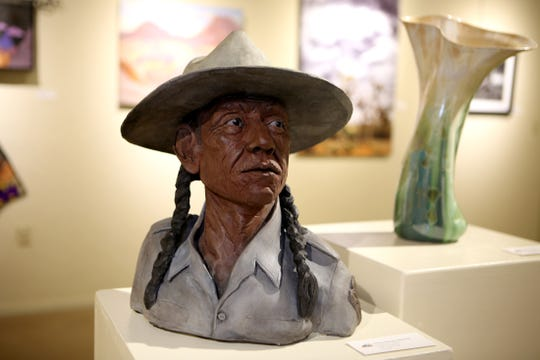 Clay sculpture depicting a park ranger by artist Valerie Messervy Birkhoff is shown during The Joshua Tree National Park Art Exposition in Twentynine Palms, Calif., on Saturday, September 14, 2019.