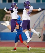 At left Jaden Donovan and Jake Shipley of Shadow Hills High School celebrate the first touchdown of the game during the visit to Indio High School on September 13, 2019.