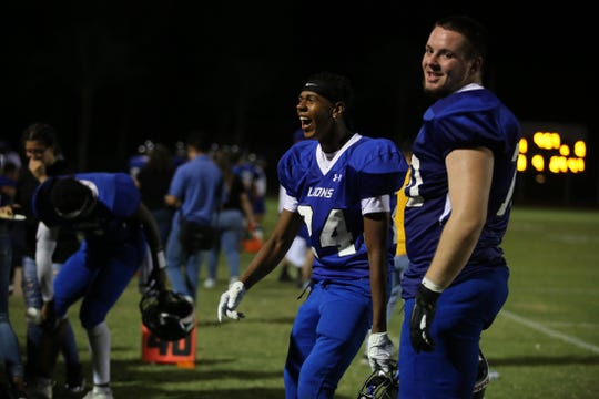 Cathedral City's Semaj Brenagh, left and Adam Scott smile in the fourth quarter of the game against Perris in Cathedral City, Calif., on Friday, September 13, 2019. Cathedral City won.