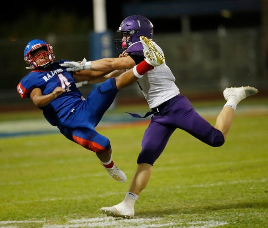 Patrick Zamora Jr. of Indio High School gets hit after throwing the ball by Shadow Hills High School's Jaden Donovan on September 13, 2019.