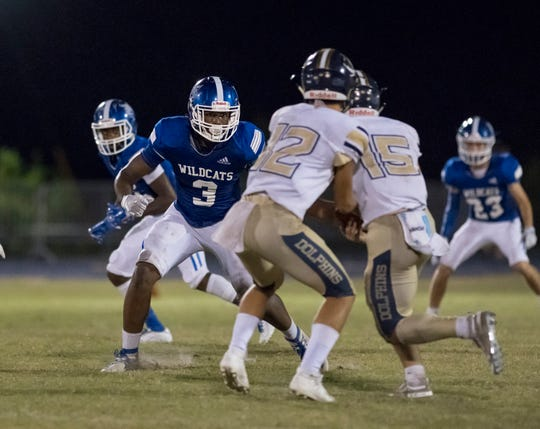 Eric Thomas Jr. (3) pursues the ball carrier during the Gulf Breeze v Washington football game at Booker T. Washington High School in Pensacola on Friday, September 13, 2019.