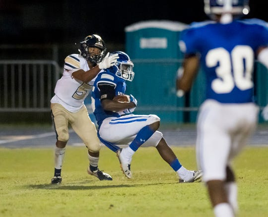 Javarous Harrison (25) intercepts the ball in front of Devon Baldwin (5) during the Gulf Breeze v Washington football game at Booker T. Washington High School in Pensacola on Friday, September 13, 2019.