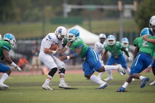 UWF's Quentin Peebles (13) sacks Shorter quarterback Tyler PUllup during a game on Sept. 14, 2019. UWF won 42-14.