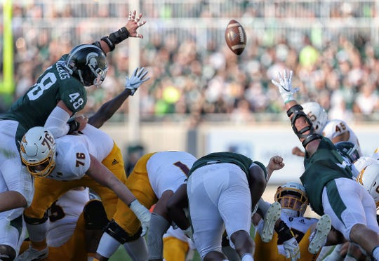 Sep 14, 2019; East Lansing, MI, USA; Michigan State Spartans defensive end Kenny Willekes (48) attempts to block a field goal by Arizona State Sun Devils place kicker Brandon Ruiz (not pictured) during the first half at Spartan Stadium. Mandatory Credit: Mike Carter-USA TODAY Sports