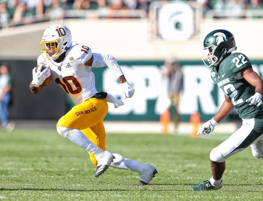 Sep 14, 2019; East Lansing, MI, USA; Arizona State Sun Devils wide receiver Kyle Williams (10) runs after a catch against Michigan State Spartans cornerback Josiah Scott (22) during the first half at Spartan Stadium. Mandatory Credit: Mike Carter-USA TODAY Sports
