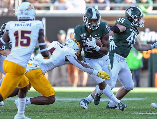Arizona State's Evan Fields tries to make a tackle on Michigan State receiver Darrell Stewart Jr. during the first half of a game Sept. 14 at Spartan Stadium.
