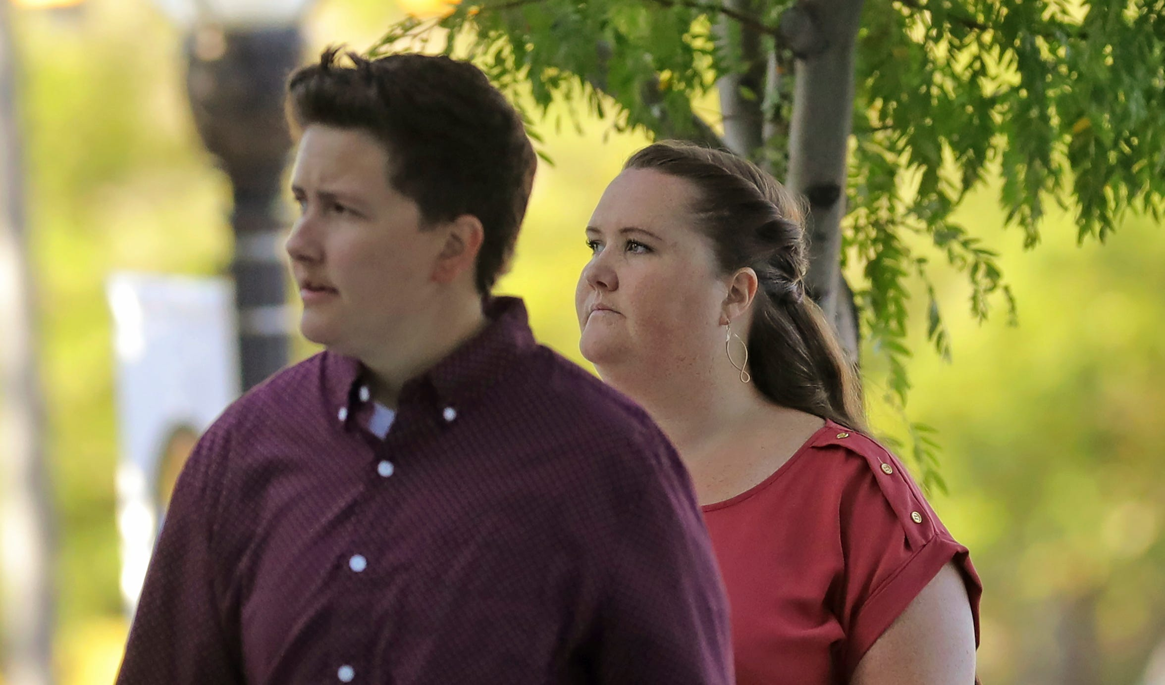 In this Aug. 14, 2019, photo, Alexandrya Tonge, left, and Katherine Bustin, rear, arrive at the federal courthouse in Salt Lake City. Alexandrya Tonge and Katherine Bustin pleaded guilty to divvying up and packaging tens of thousands of pills, then shipping them to customers through the U.S. mail for Aaron Shamo as he built a multimillion-dollar fentanyl trafficking empire.