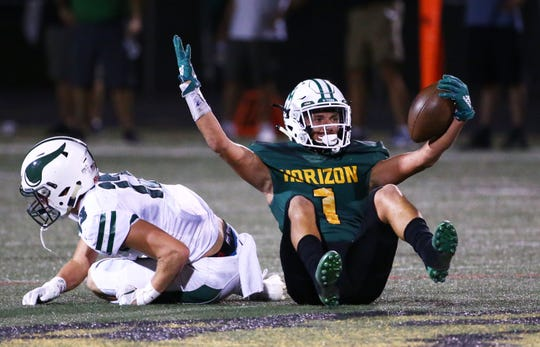 Horizon High wide receiver Canaan Mullins (1) reacts after a tackle by Sunnyslope High defensive back Ashton Yurkiw (13) in the first half on Sep. 13, 2019 in Phoenix, Ariz.