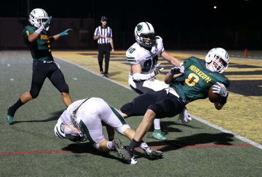 Horizon High tight end Jay Rudolph (8) carries the ball to the 1-yard line against Sunnyslope High in the first half on Sep. 13, 2019 in Phoenix, Ariz.