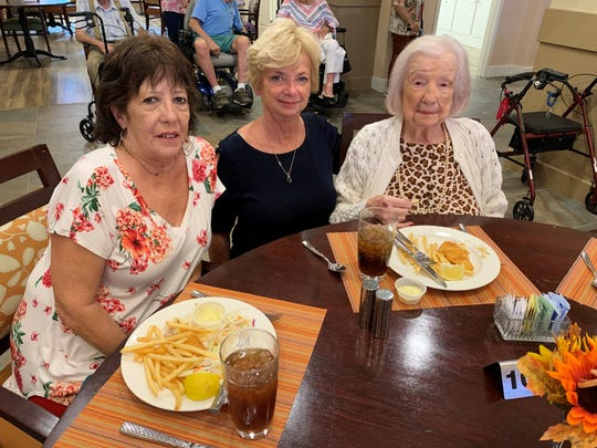 (From left) Leigh Whitaker, Nancy Meegan and Edna Collins pose for a photo on Sept. 13, 2019, during Collins' 105th birthday celebration at a senior living facility in Peoria.