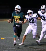 Horizon High quarterback Jake Martinelli (10) carries the ball against Sunnyslope High in the first half on Sep. 13, 2019 in Phoenix, Ariz.