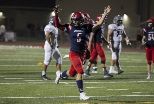 American Leadership Academy quarterback Rand Jensen (5) celebrates a touchdown pass against the Phoenix Christian defense during the first half of their game in Queen Creek.
