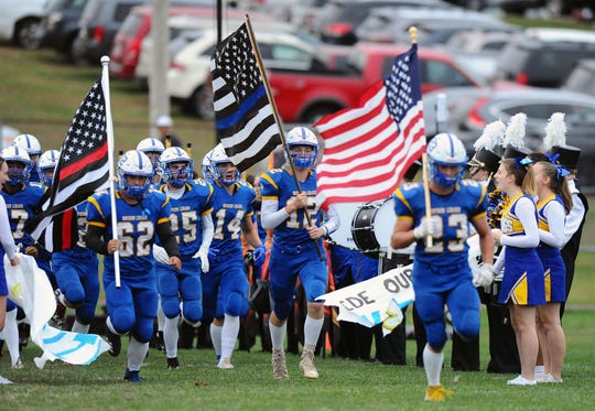 The Northern Lebanon Vikings take the field before the game between NL and the Annville Cleona H.S. Dutchmen played Friday Sept.13,2019 at Northern Lebanon High School's Frederick L.Gahres Stadium.