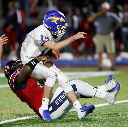 Roy C. Kecham's Jayden Lassiter takes down Mahopac's Jack Carey during Friday's game on September 13, 2019.
