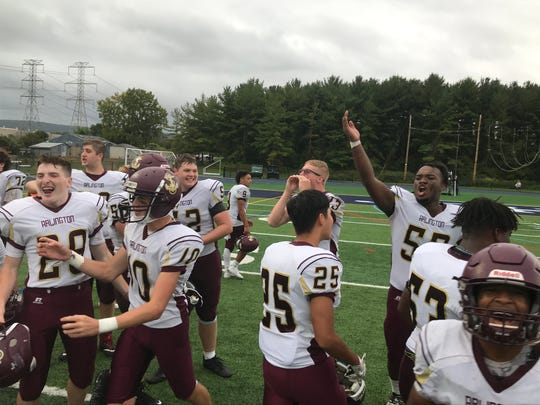The Arlington High School football team celebrates its 24-16 win over John Jay-East Fishkill on Saturday.