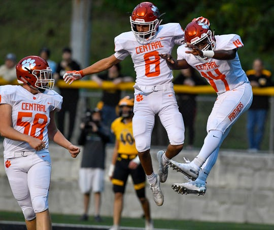 Central York's Mason Myers (8) and Imeire Manigault celebrate the Panthers first touchdown against Red Lion after Myers ran the ball into the end zone on the first series, Friday, Sept. 13, 2019 John A. Pavoncello photo