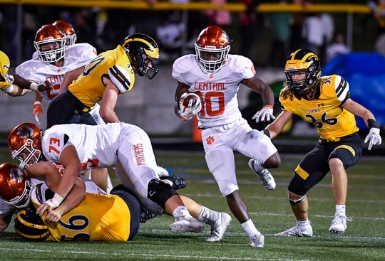 Central York's Brendan Harris (10) dodges and weaves his way through the line for good yardage against Red Lion, Friday, September 13, 2019 John A. Pavoncello photo