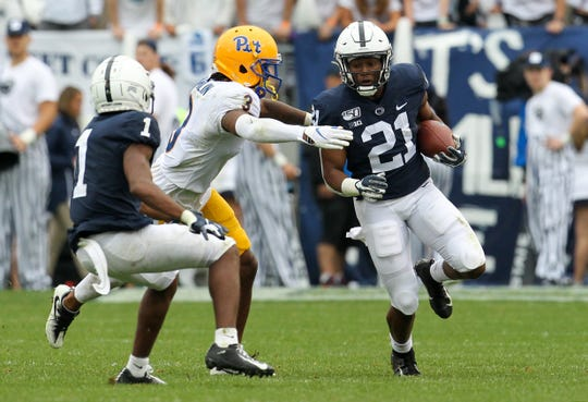 Sep 14, 2019; University Park, PA, USA; Penn State Nittany Lions running back Noah Cain (21) runs the ball against the Pittsburgh Panthers during the third quarter at Beaver Stadium. Mandatory Credit: Matthew O'Haren-USA TODAY Sports