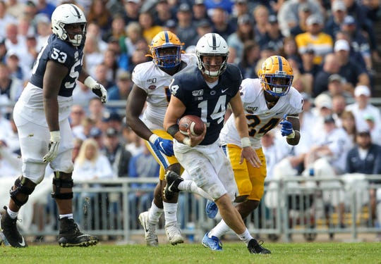 Sep 14, 2019; University Park, PA, USA; Penn State Nittany Lions quarterback Sean Clifford (14) runs with the ball during the fourth quarter against the Pittsburgh Panthers at Beaver Stadium. Penn State defeated Pittsburgh 17-10. Mandatory Credit: Matthew O'Haren-USA TODAY Sports