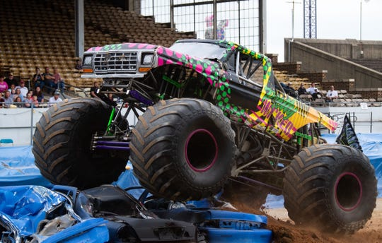 Lindsey Rettew crushes cars during the Monster Truck Fall Bash, Saturday, September 14, 2019.
