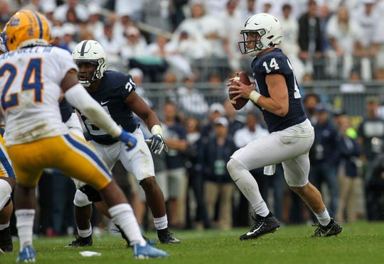 Sep 14, 2019; University Park, PA, USA; Penn State Nittany Lions quarterback Sean Clifford (14) drops back to throw a pass against the Pittsburgh Panthers during the third quarter at Beaver Stadium. Mandatory Credit: Matthew O'Haren-USA TODAY Sports