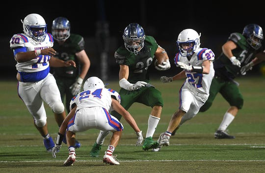 Damonte Ranch's Ashton Hayes (26) looks to run while taking on Reno during their football game at Damonte on Sept. 13, 2019.