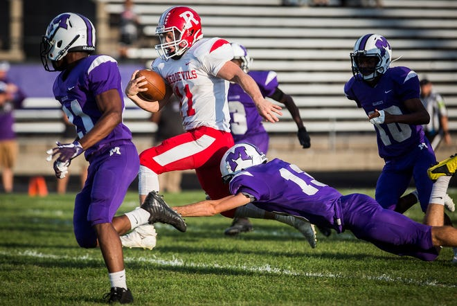Richmond's Wyatt Byrd fights past Central's defense during their game at Muncie Central High School Friday, Sept. 13, 2019.