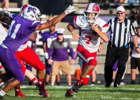 Richmond's Drew VanVleet runs the ball against Central during their game at Muncie Central High School Saturday, Sept. 13, 2019.