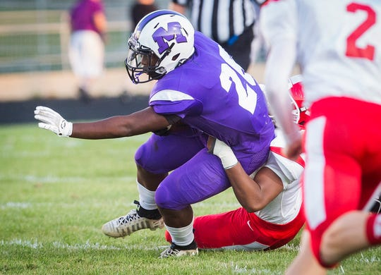 Central running back Shoka Griffin is tackled during the Bearcats' game against Richmond at Muncie Central High School Saturday, Sept. 13, 2019.