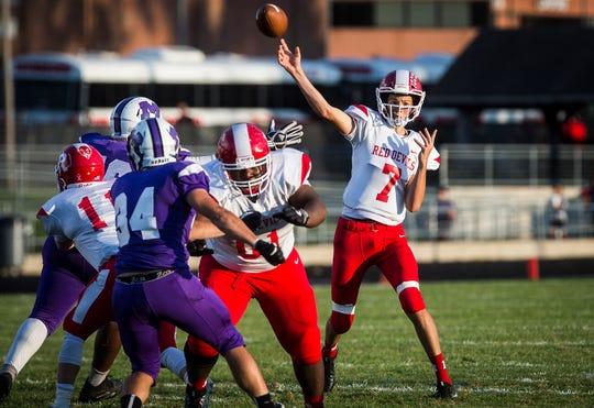 Richmond's Drew VanVleet passes against Central during their game at Muncie Central High School Saturday, Sept. 13, 2019.