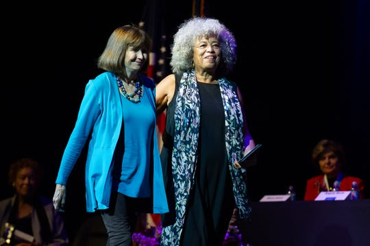 2019 Inductee Angela Davis, right, was escorted to the podium and introduced by Jean Kilbourne, during the National Women's Hall of Fame Induction Ceremony held on Saturday, Sept. 14, at the del Lago Resort & Casino in Tyre.