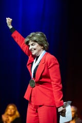 Inductee Gloria Allred raises her arm symbolizing women's power after her acceptance speech, during the National Women's Hall of Fame Induction held on Saturday, Sept. 14, in the Vine Theater at the del Lago Resort & Casino in Tyre.