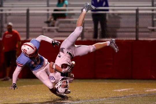 Sunset's Tom McMillan (19) flips over South Salem's Gabe Johnson (10) during the Sunset vs. South Salem football game at South Salem High School on Sep. 13, 2019. Sunset won the game 30-7.