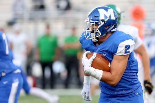 McNary's Junior Walling (2) rushes during the West Linn vs. McNary football game at McNary High School in Keizer on Sep. 13, 2019. West Linn won the game 49-14.