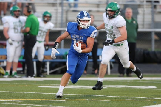 McNary's Layton Thurlow (10) rushes during the West Linn vs. McNary football game at McNary High School in Keizer on Sep. 13, 2019. West Linn won the game 49-14.