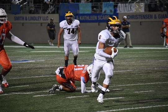 Eagles running back Braden Arriaga-Lopez (6) breaks a tackle and sprints down towards the end zone. Sept. 13, 2019.