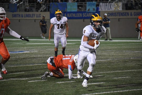 Everett Alvarez running back Braden Arriaga-Lopez (6) breaks a tackle on his way to one of four touchdowns against North Salinas. Sept. 13, 2019.