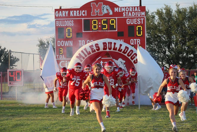 The Miles Bulldogs charge onto the field before their game against the Roscoe Plowboys on Friday, Sept. 13, 2019.