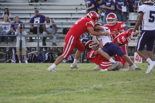 The Miles Bulldogs' defense takes down Roscoe's Ryan Highsmith during their game Friday, Sept. 13, 2019, at Gary Krejci Memorial Stadium in Miles.
